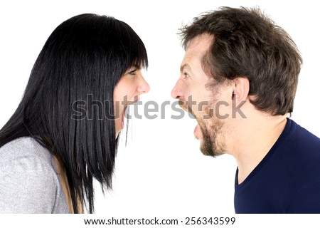 Crazy angry couple fighting hard - stock photo