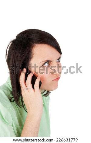 crazy angry young beautiful girl speaking the mobile phone - stock photo