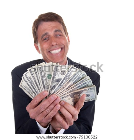 Crazy business man admiring his 20 and 100 dollar bills - focus on the money. - stock photo