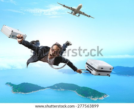 crazy business man flying from passenger plane with briefcase and luggage with glad and happiness emotion use for  people vacation holiday traveling to destination island - stock photo