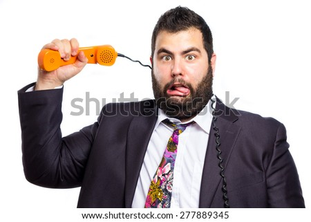 Crazy businessman choking himself with the telephone cable  - stock photo