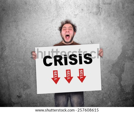 crazy businessman holding poster with crisis concept - stock photo