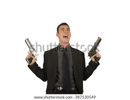 Crazy businessman in suit holding two guns - stock photo