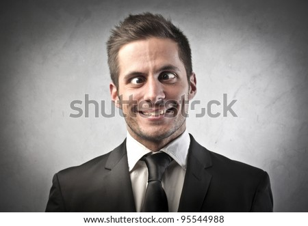 Crazy businessman making funny faces