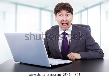 crazy businessman working with is laptop at the office - stock photo