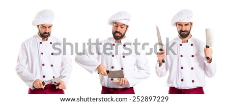 Crazy chef with knives - stock photo