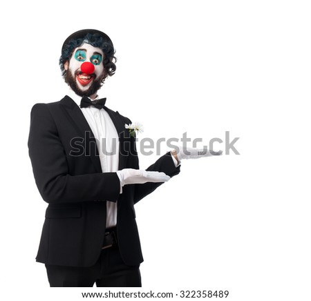 crazy clown man showing gesture - stock photo