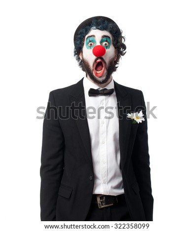 crazy clown man surprised pose - stock photo
