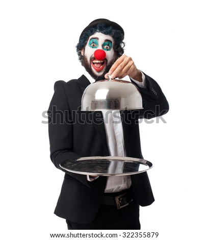 crazy clown man with tray - stock photo