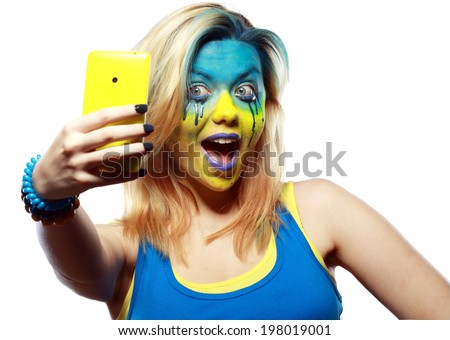 crazy color face art women portrait with yellow and blue as flag of Ukraine - stock photo