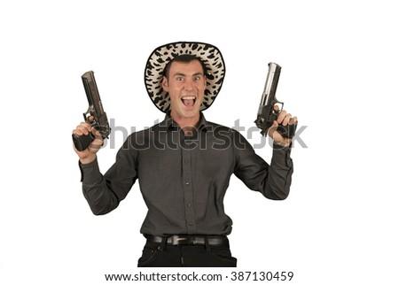 Crazy cowboy holding two guns - stock photo
