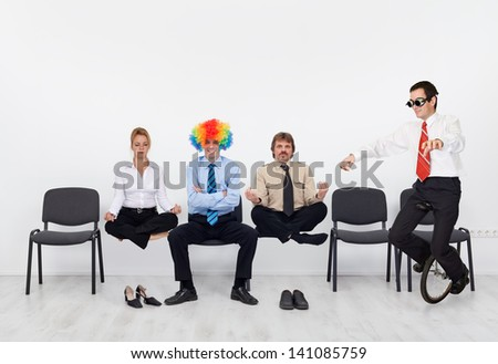 Crazy day at the office - people managing a hectic business day - stock photo