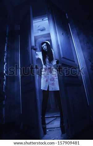 Crazy dead nurse in an abandoned hospital - stock photo