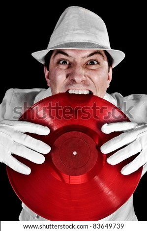 Crazy DJ Biting Record wearing white hat, suit and gloves - stock photo
