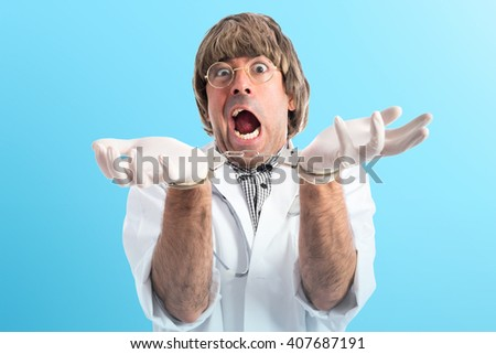 Crazy doctor with handcuffs - stock photo