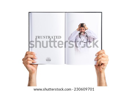 Crazy doctor with pills printed on book - stock photo