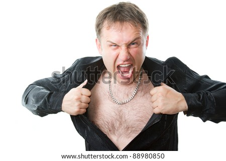 crazy evil man rips his shirt on his hairy chest on a white background - stock photo