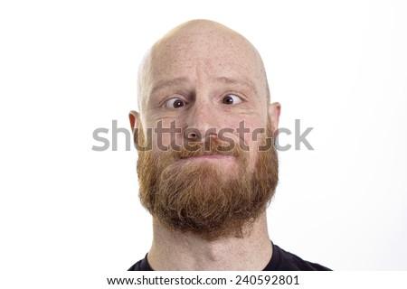 crazy face, cross eye,  bald, red beard man - stock photo