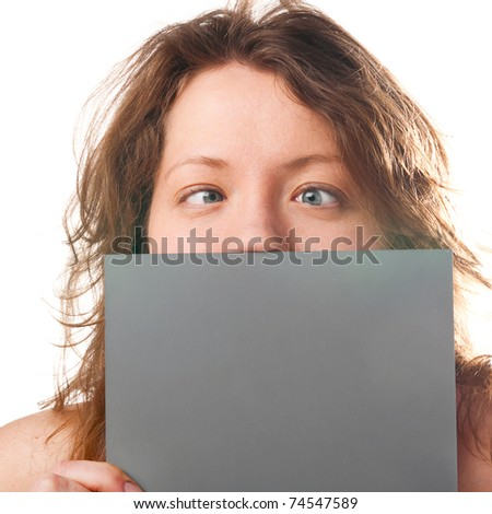 crazy funny caucasian woman is holding grey plate - stock photo