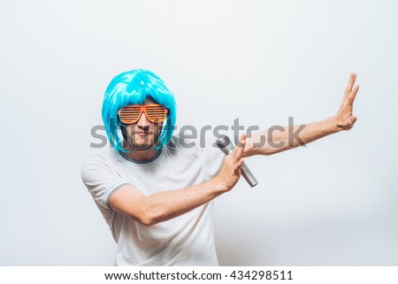 crazy funny young man with blue wig - stock photo