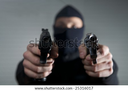 crazy  gangster hold guns in his hands - stock photo