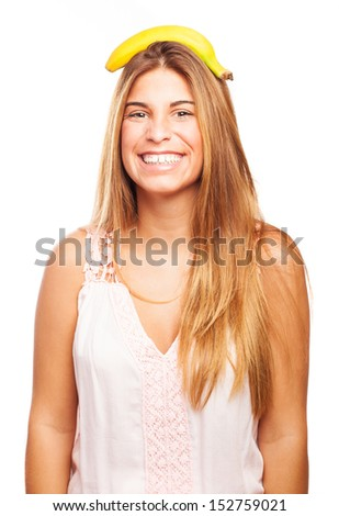 crazy girl with a banana over her head - stock photo