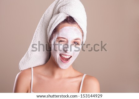 Crazy girl with facial mask - stock photo