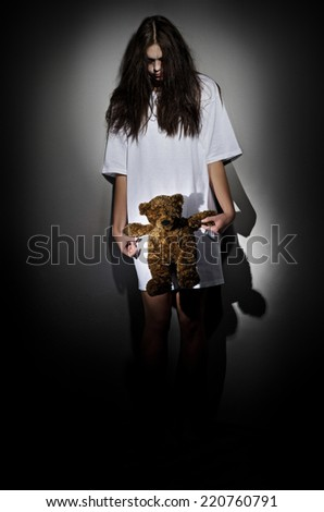 Crazy girl with teddy bear - stock photo