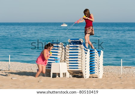 Crazy girls having a lot of fun at a water fight - stock photo
