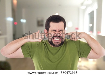 Crazy guy covering her ears - stock photo