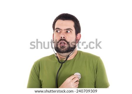 Crazy guy earing heart using stethoscope - stock photo