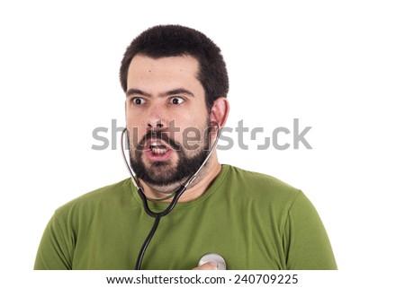 Crazy guy using stethoscope - stock photo
