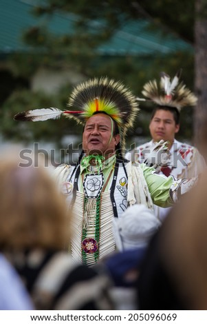 Crazy Horse Memorial, South Dakota  - June 15 : Native American performing for a crowd in the Black HIlls, June 15 2014 in the Crazy Horse memorial, South Dakota - stock photo
