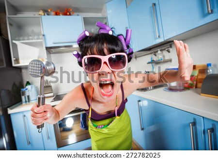 Crazy housewife in an interior of the kitchen. Family problems. - stock photo