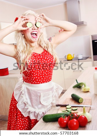 Crazy housewife is having fun in the kitchen, similar available in my portfolio - stock photo