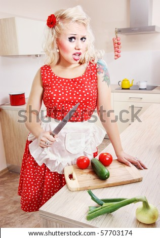 Crazy housewife with a knife, similar available in my portfolio - stock photo