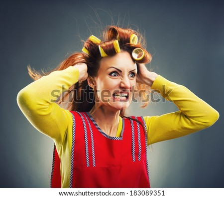 Crazy housewife with curlers - stock photo