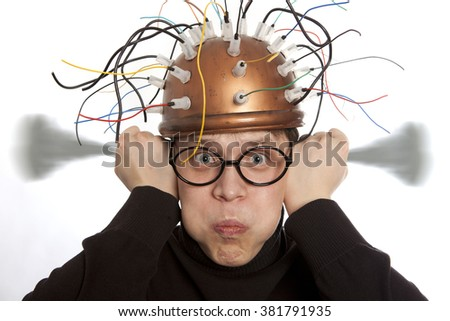 Crazy inventor helmet for brain research - stock photo