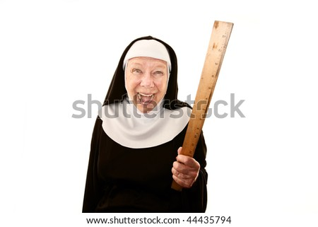 Crazy ;laughing nun on white brandishing a ruler - stock photo