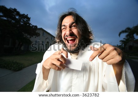 Crazy looking man shownig a blank business card.