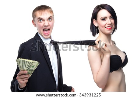 Crazy man and woman holding his tie. Isolated photo of people with white background. - stock photo
