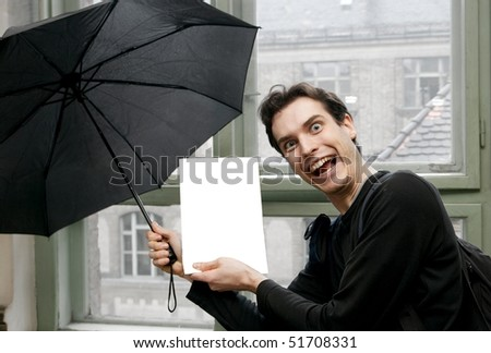 Crazy man showing an empty sheet, add your own text and images - stock photo