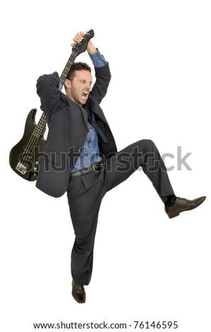 Crazy man smashing a guitar isolated in white - stock photo