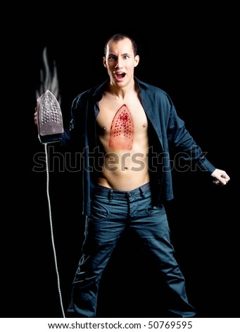 Crazy man with a hot burn on the chest - stock photo