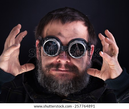 Crazy man with broken goggles having a rage attack - stock photo