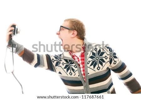 Crazy man with camera shooting him self isolated on a white - stock photo