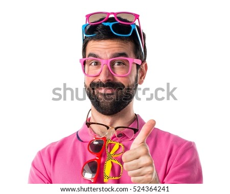 Crazy man with meny glasses