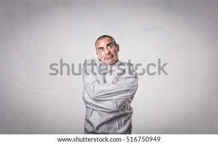 crazy man with straitjacket looking up