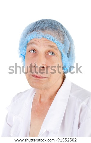 crazy middle aged man in the white uniform and doctor blue cap looking up - stock photo