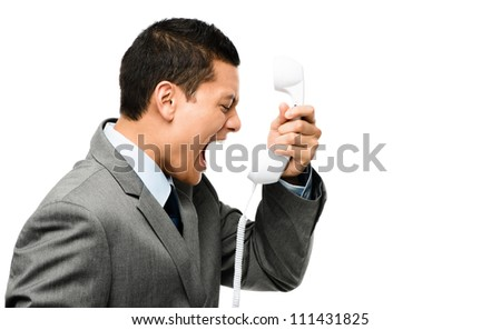 Crazy mixed race businessman screaming at telephone isolated on plan white background